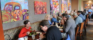Bright artwork by Mylette Welch overlooks lunch patrons at Buckhorn Grill in midtown Sacramento'